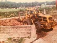 A 1970s Weatherill L61 4WD Loader Diesel working in a farm