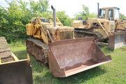 Cat 933G traxcavator at EM wd 2011 - IMG 0497
