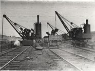 A pair of Whitaker Brothers Steamcranes with a JH Wilson Steamcrane all working at the Manchester Ship Canal in 1906