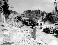 Military convoy through Saint Lo