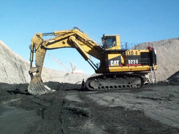 a caterpillar 5230 in mass excavation form