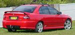 Red sedan automobile