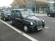 A TX4 Taxi at Heathrow Airport Terminal 5