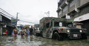 US Navy 091004-M-9443M-134 Members of the U.S. Armed Forces and the Armed Forces of the Philippines deliver family food packs