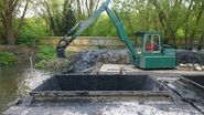 A 1990s Smalley 450 Excavator Diesel river cleaning