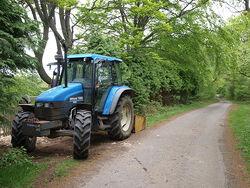 Tractor on Ridge Lane - geograph.org.uk - 802657