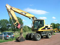 Caterpillar M318 with grab