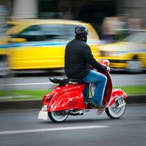 Red scooter rider Avenida Do Mar, Funchal, Madeira Island