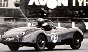 XK120 racing at Silverstone