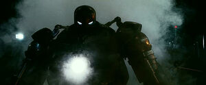 Starscream as Iron Monger