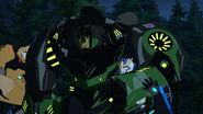 As the Kospego commands! Strongarm helps Grimlock