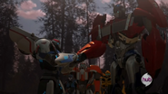 Optimus and Smokescreen Shake Hands