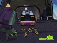 Swindle flattened by optimus prime