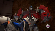 Optimus and Smokescreen (After the battle against Starscream)