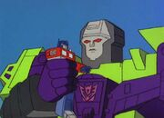 City of Steel Optimus Prime in Devastator's Hand