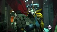 Optimus hand on Arcee