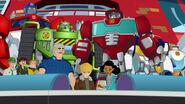 Burnsit, Rescue Botit, Optimus ja Frankie uuden aika-kapselin kanssa.