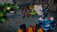 Bee Team, Blurr, Russell and Denny with Defeated Springload