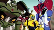Optimus, Bulkhead, Sari, Prowl and Bumblebee