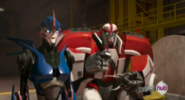 Arcee talks to Ratchet about Smokescreen