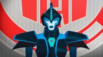 Cyberwarp speaks to the Autobots