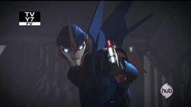 Orion Pax part 3 screenshot Arcee blaster
