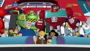 Rescue Bots, Burns Family and Optimus with a new time capsule