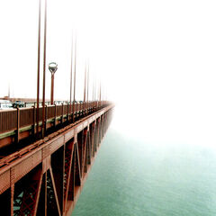 The Golden Gate Bridge on a typically foggy day in July.