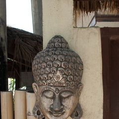 Mask on the wall, Jogjakarta, Java, Indonesia