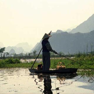 Boy fishing near the Perfume Pagoda