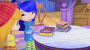 Blueberry is showing Apple her books