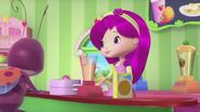 Raspberry blends ingredients in a blender