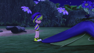 Sour is standing next to her tent