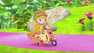 Apple on her scooter
