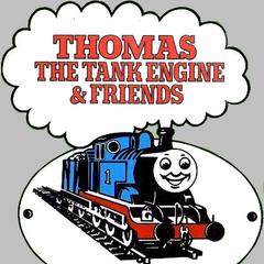 1983年の四色表現(白・黒・青・赤)のロゴ