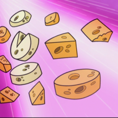 The cheese as it is falling into Snaptrap's mouth.