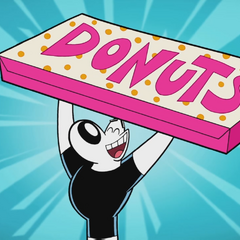 Dudley holding a big box of donuts.