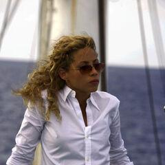 Elizabeth Rodríguez como Gina Calabrese em Miami Vice.