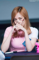 Mina wearing glasses