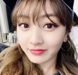 Jihyo wearing a cap