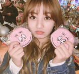 Jihyo holding to plushies