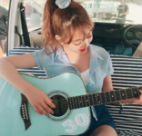 Jihyo playing the guitar