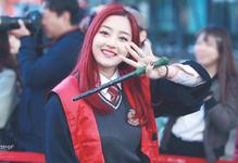Jihyo holding a wand