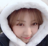 Jihyo wearing a furry hat