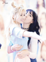Nayeon kissing Sana on the cheek