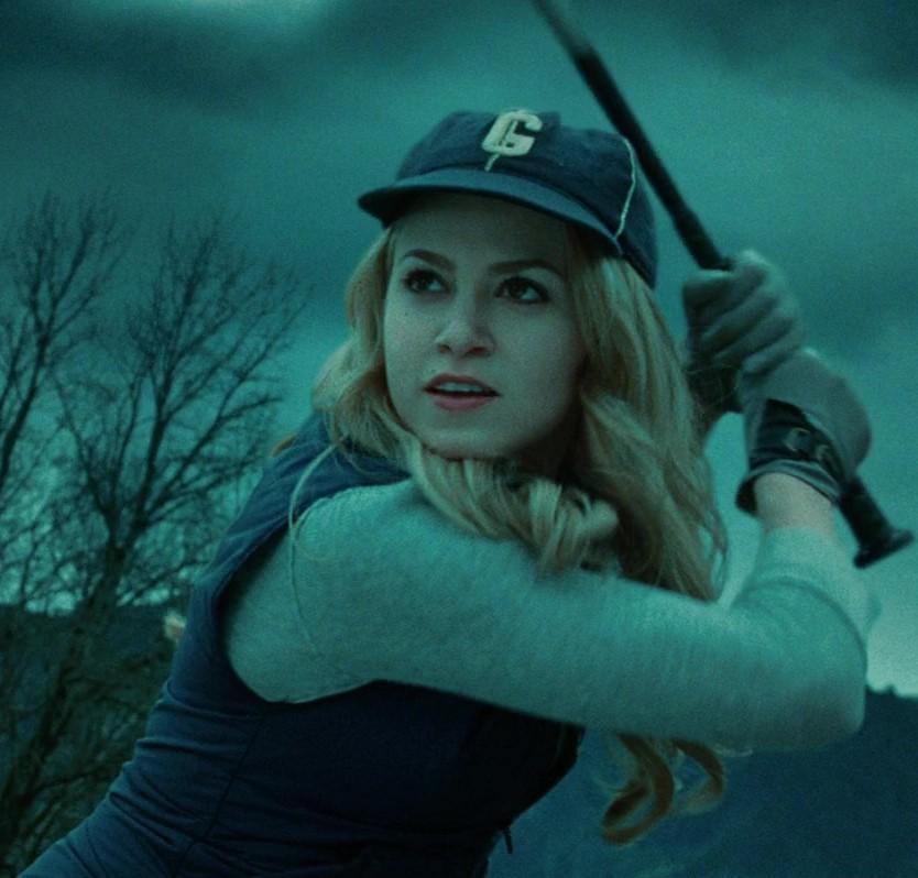 Rosalie playing baseball
