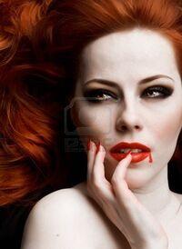 7003804-closeup-portrait-of-beautiful-redhead-vampire-woman