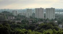 The-blocks-of-flats-on-the-bromford-estate-the-low-rise-houses-among-the-trees-in-the-foreground-are-on-the-firs-estate-in-the-distance-can-be-seen-the-dudley-hills