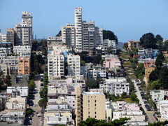 Aerial photo of hill in San Francisco, with many multistory buildings