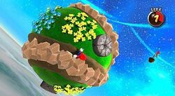 In this screenshot, Mario is running across a small, circular planetoid in outer space. The game has gravity mechanics which allows Mario to run upside down or sideways.